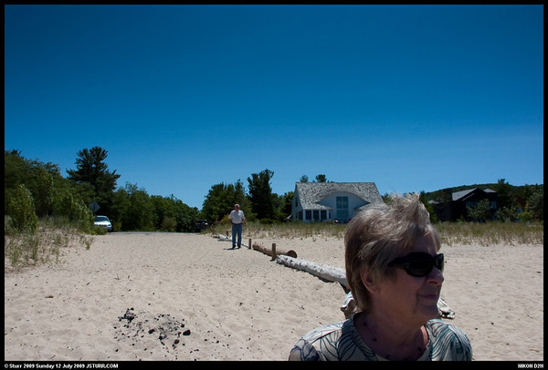<b>Submitted By:</b> JOHN STURR <b>From:</b> SALT LAKE CITY <b>Description:</b> Thomas and Dolores Sturr enjoy a quick break from driving by visiting one of the many access points to the shore of Lake Michigan from the town of Glen Arbor, Michigan.