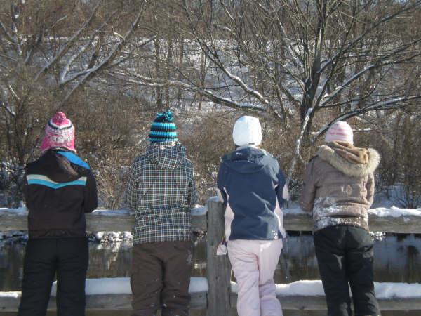 These girls are sisters/cousins and the photo was taken while snowshoeing <br /> along the Boardman River.<br /> <br /> Phyllis Zimmer