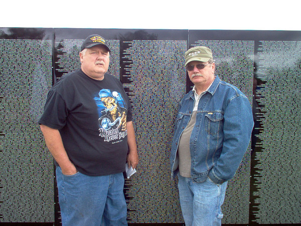Disabled Vietnam Veterans Mike Fitzpatrick (left) and Dan Santoro (right) of <br /> Lake City Michigan Paying Tribute to Fallen Comrades at Moving Vietnam Wall <br /> Memorial in Kalkaska Sunday 8/10/2008.    Picture Taken by Lori Santoro of <br /> Lake City Michigan.
