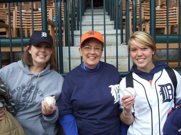 <b>Submitted By:</b> Sue Miles <b>From:</b> Traverse City <b>Description:</b> Several women in my family took my mother, Shirley Goodrich, (as a gift for her 79th birthday) to what we thought was to be the last regular season Tiger game in Detroit. This was something she's really wanted to do for quite awhile. The game was great and the Tigers won, but she was not able to meet Brandon Inge as she had hoped. However, something else happened that made the day pretty memorable. Two of my nieces (one who currently lives in TC and one who used to live in TC) were sitting next to each other and both caught foul balls! Andrea Goodrich Gastmier, left, age 29, formerly of TC who now teaches kindergarten for South Lake Schools in St. Clair Shores, caught Magglio Ordonez's in the first inning and her cousin, Jenn Goodrich, right, age 19 and currently an NMC student, caught Ryan Rayburn's in the eighth!