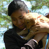 <b>Submitted By:</b> Glenn Socia <b>From:</b> Interlochen <b>Description:</b> This young lady held this pup for the first time.  I was able to capture the moment.