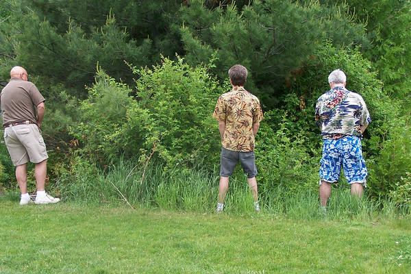 Three people looking at something<br />  <br /> Lori Montero<br /> Torch River<br />  <br /> Picture was taken at Agaming golf course