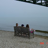 Shanna, Asher & Tasha Hilborn on a bench under the Mackinac Bridge, June 2008