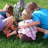 <b>Submitted By:</b> Elaine Umlor <b>From:</b> Traverse City <b>Description:</b> Three little granddaughters smelling the pansies.