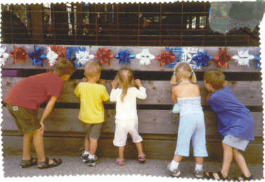 "I know this has five people in the photo, not three, but it is so cute of my <br /> grandchildren, I thought it might be worthy of being put in the paper.<br /> <br /> ""Spencer, Griffin, Hadley, Jaden and Cole at the fair."""