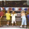 """I know this has five people in the photo, not three, but it is so cute of my <br /> grandchildren, I thought it might be worthy of being put in the paper.<br /> <br /> """"Spencer, Griffin, Hadley, Jaden and Cole at the fair."""""""