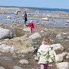 This picture was taken Sunday, May 17th in front of the Old Mission <br /> Lighthouse. My three grandchildern were searching for pretty stones to make <br /> pictures frames for family and friends. It was a beautiful day to take a <br /> ride up Old Mission Peninsula to view Northen Michigan's beauty and take the <br /> time to smell the Cherry Blossoms and other flowers in bloom.<br /> <br /> Sandra Pyle<br /> South Boardman MI