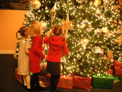 These are my great-nieces, Ella (age 5), Molly (age 6) and Paige (age 6) - <br /> the picture was taken in the lobby of the Amway Grand hotel in Grand Rapids <br /> a couple of weeks ago, prior to seeing The Nutcracker.<br /> <br /> Submitted by Brooke Clark<br /> Cadillac