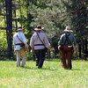 You seem to like photos of the backs of three things.  Here's one I took at <br /> the Grand Traverse Rendezvous at the Benzie Sportsman's Club last Sunday. <br /> Three reenactors are heading into the woods to do some shooting.<br /> <br /> Barb Horning<br /> Suttons Bay