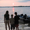 Picture taken of three of my my grandchildren at Higgins Lake, MI., 01  <br /> September 2007. Here are Hannah, Aaron and Noah Hughes looking at a  <br /> colorful sunset.<br /> <br /> Corey J. Hughes, P.S.