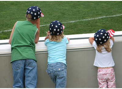 "My three kids watching an ""Independence Day"" Beach Bums Game on July 3, <br /> 2007.<br /> <br /> Wendy Webb"