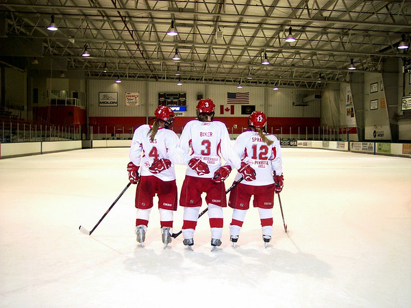 This is a picture of 3 girls from U-19 Traverse City North Stars hockey team <br /> looking down the ice. It is Jenny Gies #4, Kiersten Sprague #12 and Danika <br /> Baker #3.<br /> <br /> Submitted by Lynn Sprague