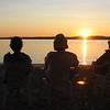<b>Submitted By:</b> Kathleen Hayes <b>From:</b> Traverse City <b>Description:</b> Karen, Quinn and Memzie enjoy another beautiful sunset on East Bay.