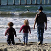 Photo by Julie Quinn, Manistee, MI<br /> <br /> Photo taken in Ocean Beach, CA, November 2003. Before moving to Michigan, we <br /> took our annual holiday card photo of the kids on the beach each year. This <br /> was an extra from that year's shoot.