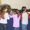 "Dec. 17, 2008, I took this shot of three youngsters watching the trains at <br /> The Traverse City Heritage Center's ""Festival of Trains"".<br /> <br /> Sue Baker"