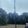 Record-Eagle/Sarah Anderson<br /> Sarah snapped a shot of broken power lines just as a bolt of lightning struck the pole in Elk Rapids during Sunday's storm.