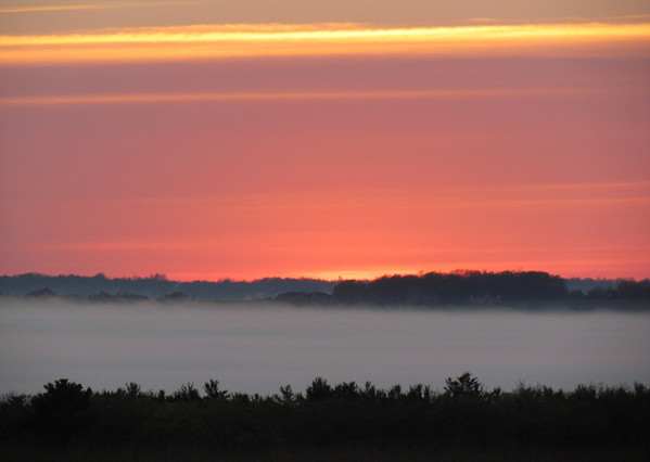 <b>Submitted By:</b> Lucy Hunter <b>From:</b> Williamsburg, MI <b>Description:</b> Fog over Grand Traverse Bay. Sunset pic taken from US 31 North -- right near Turtle Creek Casino