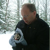 This picture was taken in Interlochen December 2008.<br /> Kelly Brown found a baby possum in her backyard. Her dad Chris Brown says it <br /> came out of hibernation. The baby possum was scared and cold. The snow was <br /> to deep for him to go anywhere. Chris warmed it up, took some pictures with <br /> it and hopes it found a new place to hibernate.
