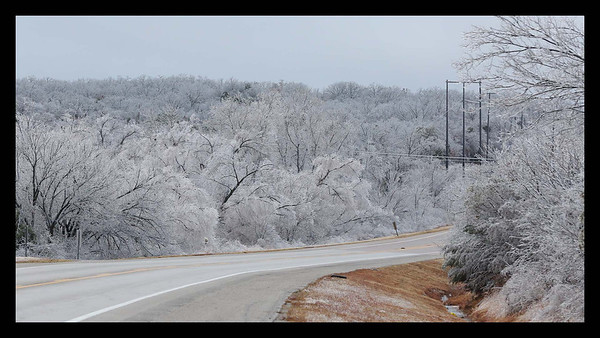 A view of the ice coated landscape off Highway 9  looking west towards Norman on Saturday afternoon Dec 21st.<br /> <br /> Photographer's Name: Bill Noesges<br /> Photographer's City and State: Norman, OK