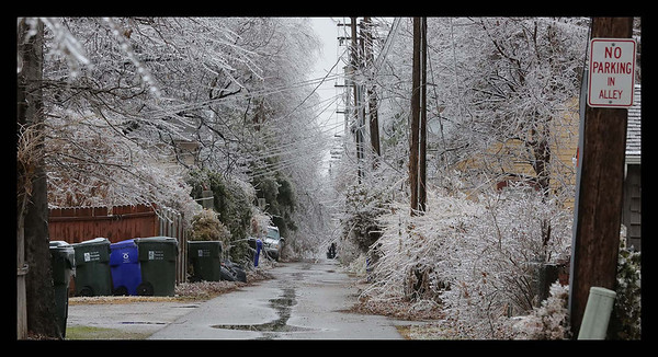 An alleyway is coated in ice in a neighborhood off of W Boyd St. in Norman on Saturday Dec 21st..<br /> <br /> Photographer's Name: Bill Noesges<br /> Photographer's City and State: Norman, OK