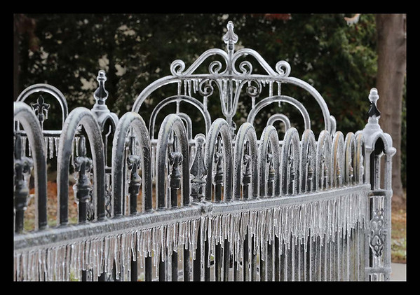 In SE Norman, the wrought iron fencing is coated in ice at a church on W Boyd St  (Dec21st)<br /> <br /> Photographer's Name: Bill Noesges<br /> Photographer's City and State: Norman, OK