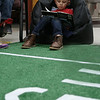 HOLLY PELCZYNSKI - BENNINGTON BANNER Bennett Walden, first grader at Bennington Elementary School gets cozy while reading a book during the reading Super Bowl event held to promote reading and celebrate the upcoming big game  featured 30 minute slots of silent reading, on astroturf and comfortable seating for each grade.
