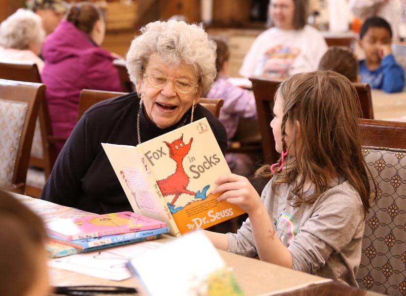"HOLLY PELCZYNSKI - BENNINGTON BANNER  Caroline Wilwol, reads ""Fox in Socks"" to Grace Christian 2nd grader during a visit to the Bennington Projectof Independance Center on Wednesday morning in Bennington."