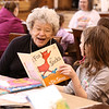 "HOLLY PELCZYNSKI - BENNINGTON BANNER  Caroline Wilwol, reads ""Fox in Socks"" to Grace Christian 2nd grader during a visit to the Bennington Projectof Independance Center on Wednesday morning in Bennington."