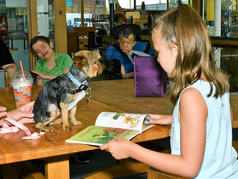 Lexi Bowen reads to Olivia at the Reading to Animals event at the Fitchburg Library on Saturday.<br /> Sentinel & Enterprise / Jim Fay