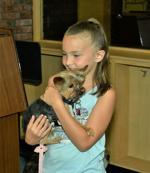 Lexi Bowen is holding Olivia, a Yorkshire Terrier, at the Fitchburg Library's Reading to the Animals event on Saturday.<br /> Sentinel & Enterprise / Jim Fay