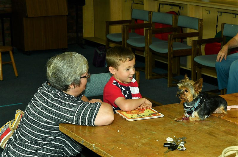 Susan Kane and Grandson, Aiden RenQuinha talking things over with Olivia at the Fitchburg Library's Reading to the Animals event on Saturday.<br /> Sentinel & Enterprise / Jim Fay