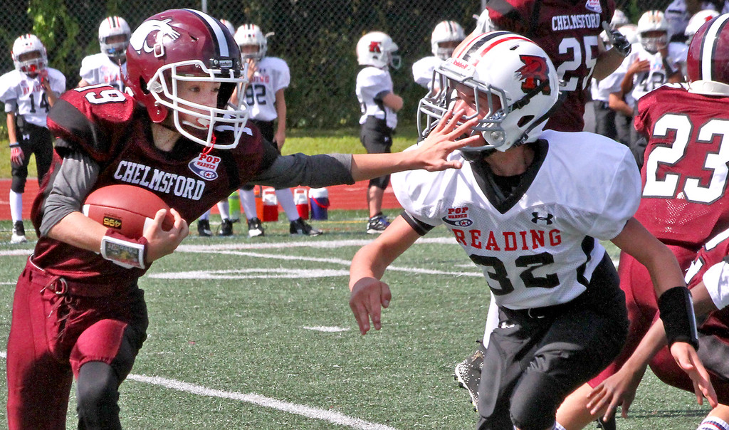 """. Chelmsford Pop Warner \""""C\"""" team player #19-Austin Nigro, looks for open space to get around Reading player. SUN Photo by David H. Brow"""
