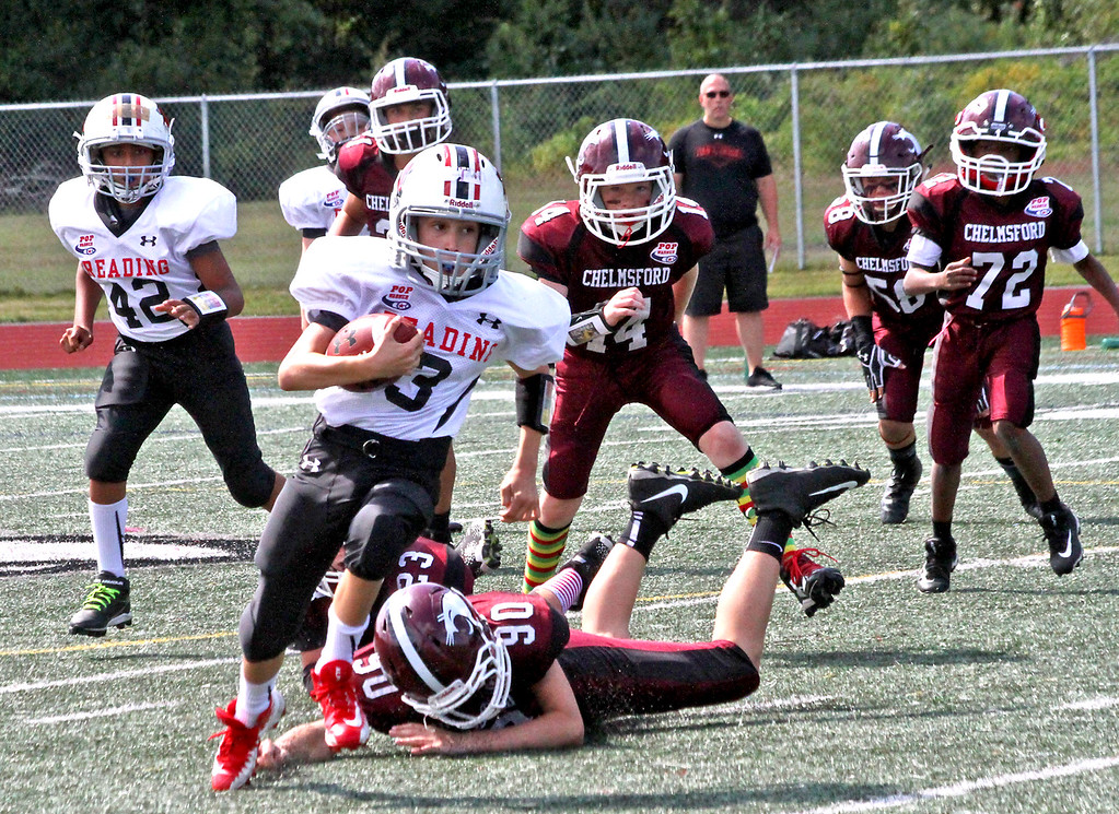 """. Ballcarrier for Reading \""""C\"""" team on the run from Chelmsford players after grabing a wild ball from a blocked pass, Chelmsford ended up winning 12~0. SUN Photo by David H. Brow"""