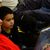 KRISTOPHER RADDER — BRATTLEBORO REFORMER<br /> Children sign up to read to a dog at the Brooks Memorial Library on Wednesday, Feb. 26, 2020.