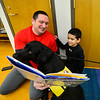 "KRISTOPHER RADDER — BRATTLEBORO REFORMER<br /> David Hoyer helps David John Hoyer, 7, as they read ""Gloria"" to Kelso, a labrador retriever, during a Pages & Paws, read to a dog program at the Brooks Memorial Library on Wednesday, Feb. 26, 2020."