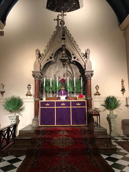High Altar with palms to be blessed on the tray