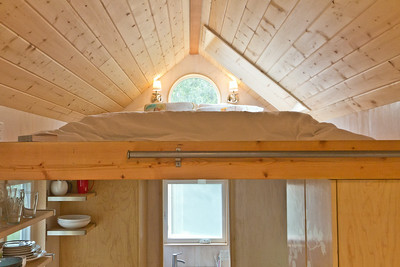 Tiny House loft above the kitchen and bathroom