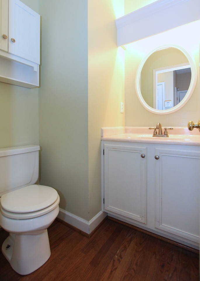 Powder room off kitchen on main level.