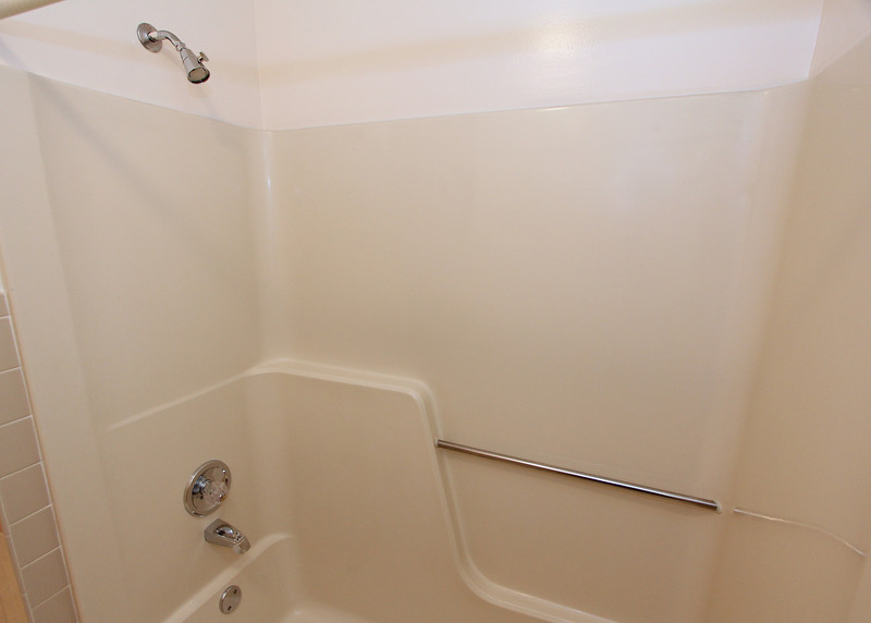 Tub/Shower in full bath off hallway.