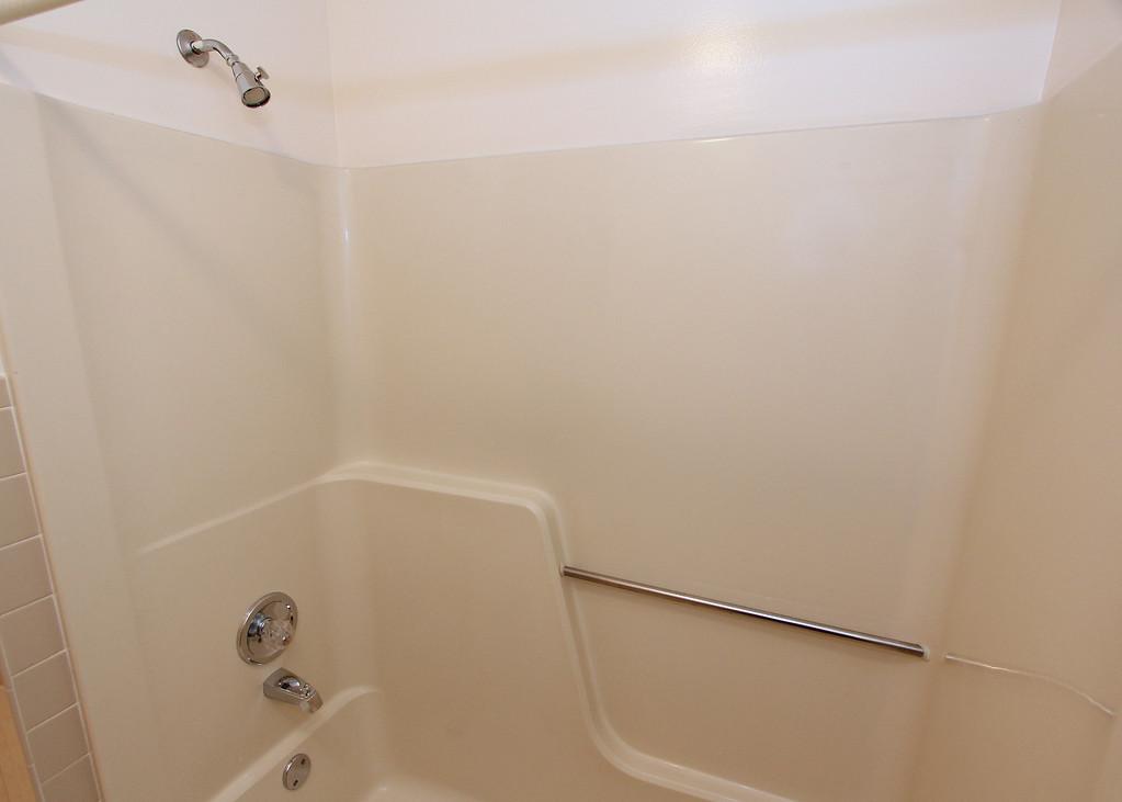 Tub/Shower in full bath off hallway.
