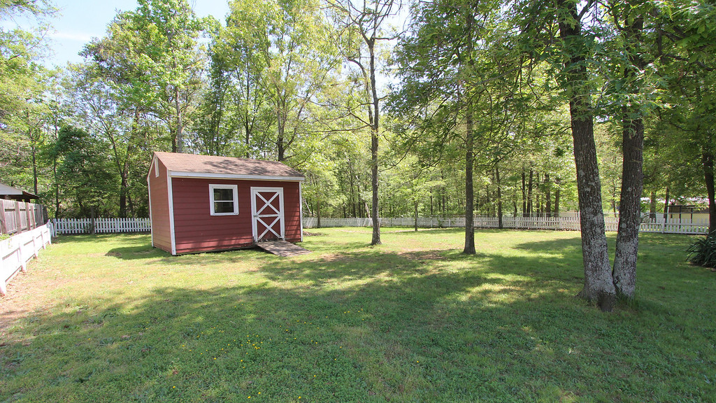 Huge back yard with shed for extra storage room!