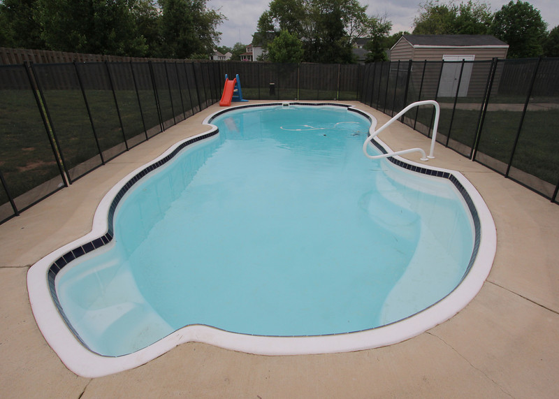 Great in-ground swimming pool w/fenced back yard!