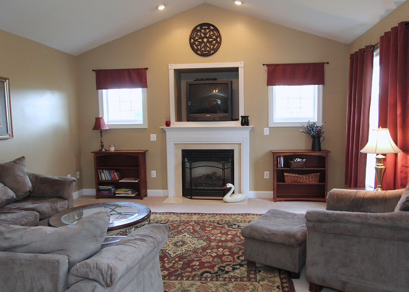Family room with vaulted ceiling off kitchen.