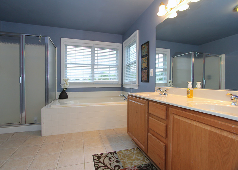 Grand Master Bath with shower, tub and dual vanities!