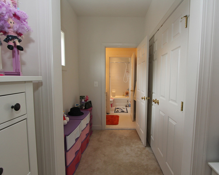 Two bedrooms share a corner full bath but both have separate vanity rooms!