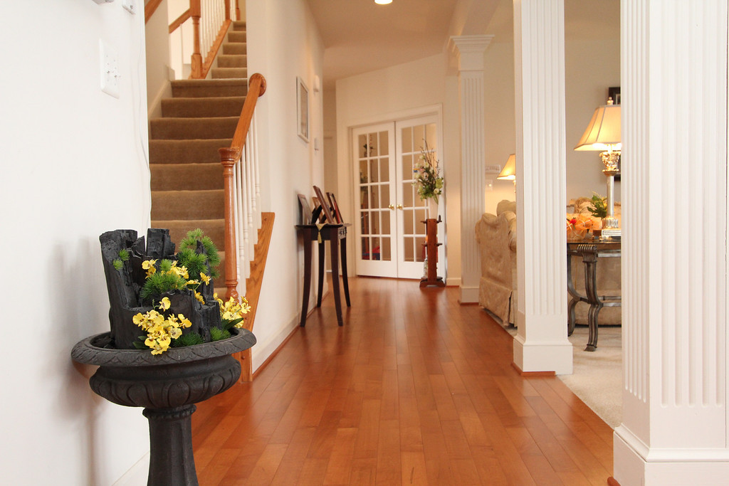 Rich wood flooring fills the main level
