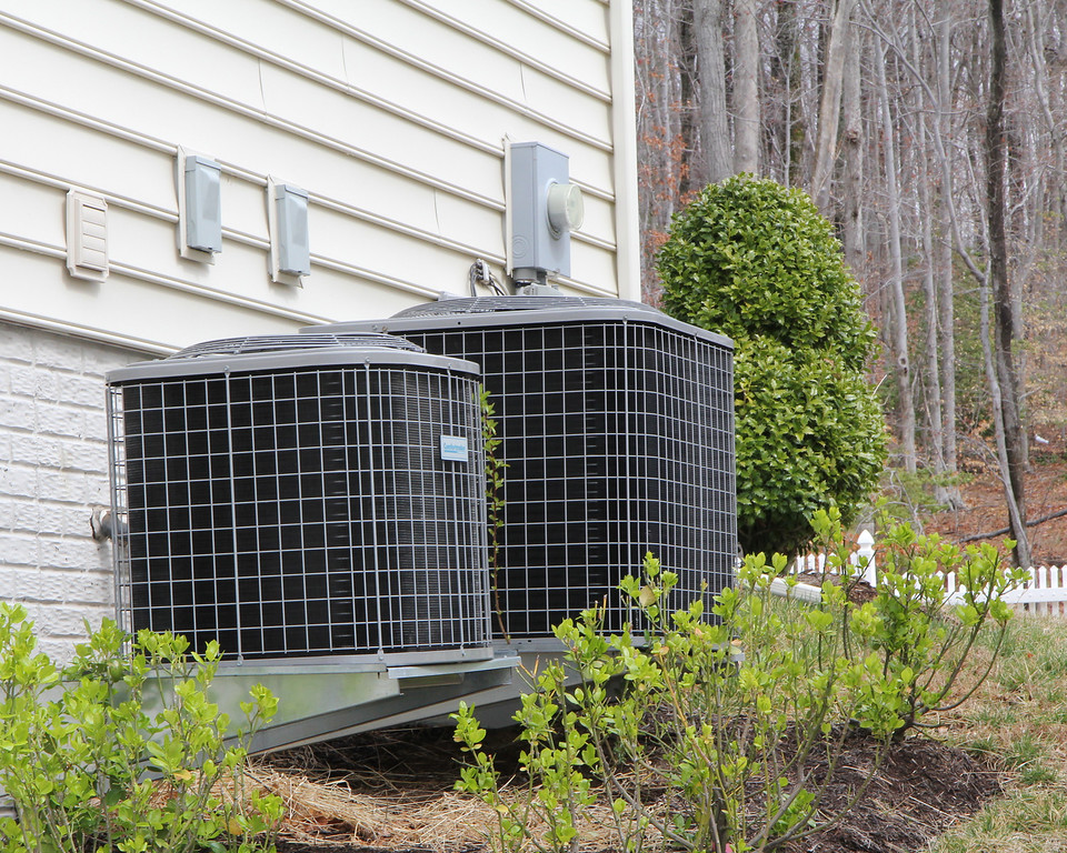 Dual zoned heat pumps run the A/C in the summer and provide heat to the upper level in the winter months.  Forced air from the natural gas furnace provides heat to the main and lower level for maximum efficiency.