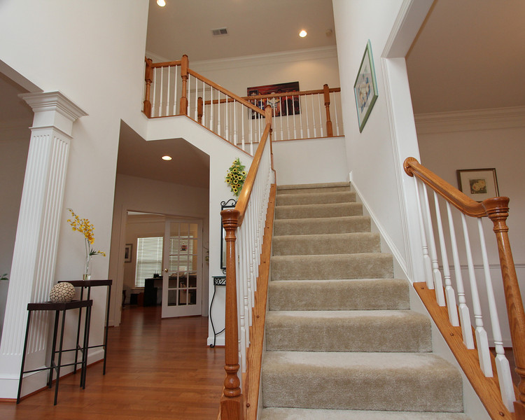 Great stairway in the grand 2-story entry foyer