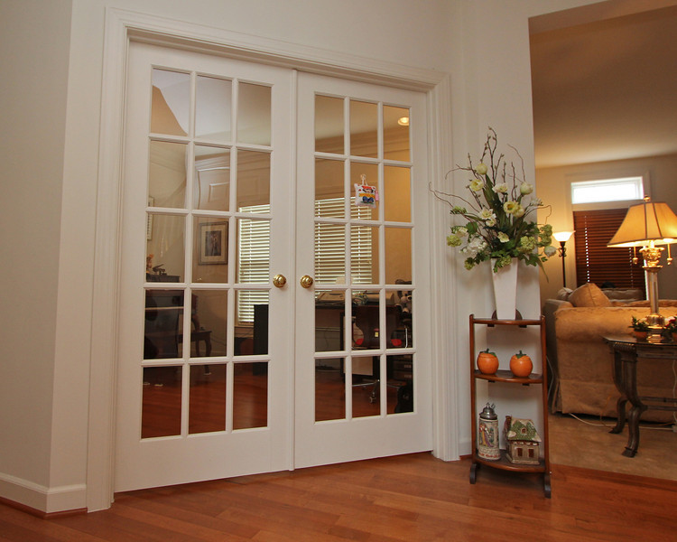 French doors open to the den/library/office on the main level