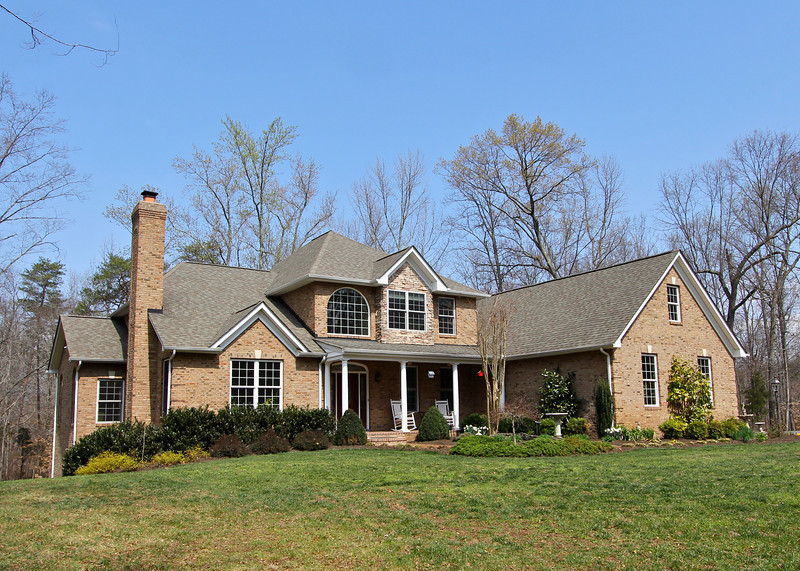2501 Wheatland Woods Drive is an amazing 3-level custom all brick home featuring 5,000 finished sq ft perfectly sited on over 7 beautiful acres.